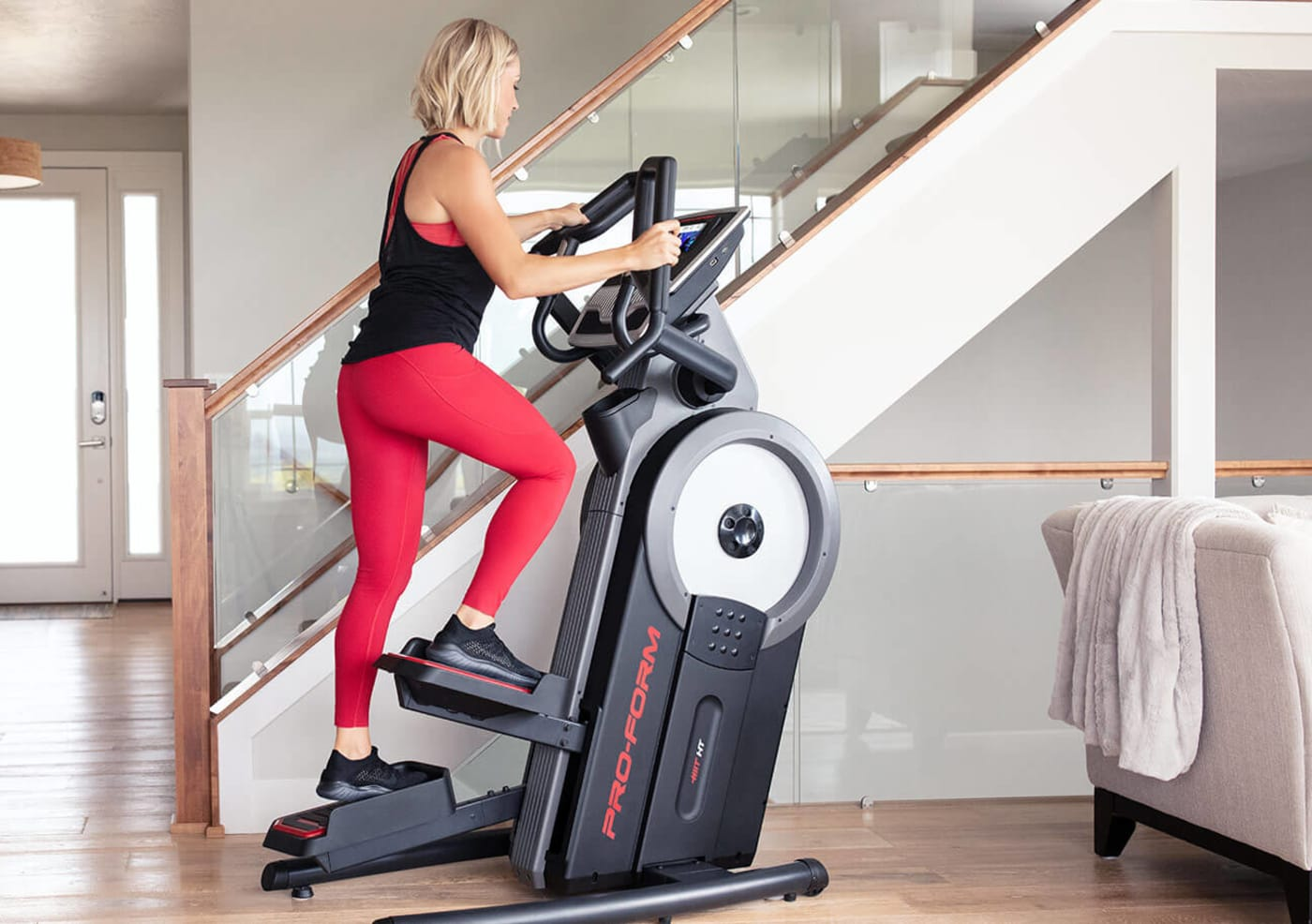 Woman riding the Carbon HIIT H7