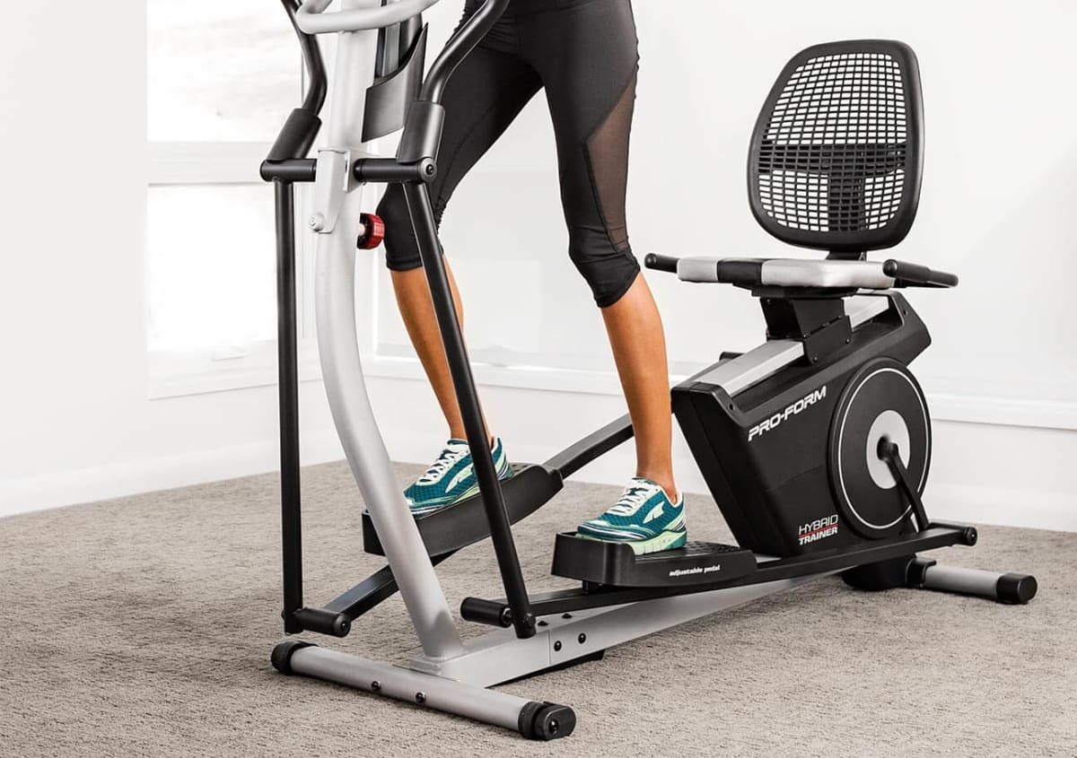 Woman using the hybrid trainer as an elliptical.