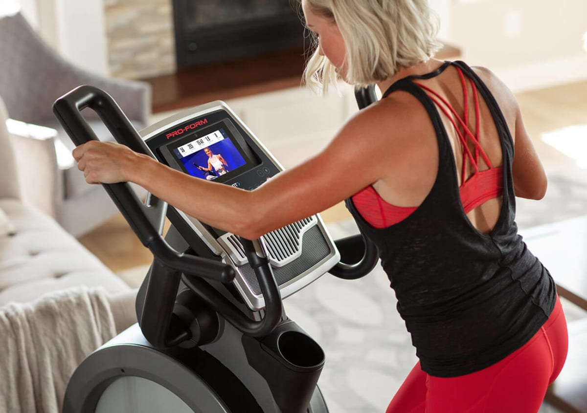 Woman riding the Carbon HIIT H7.