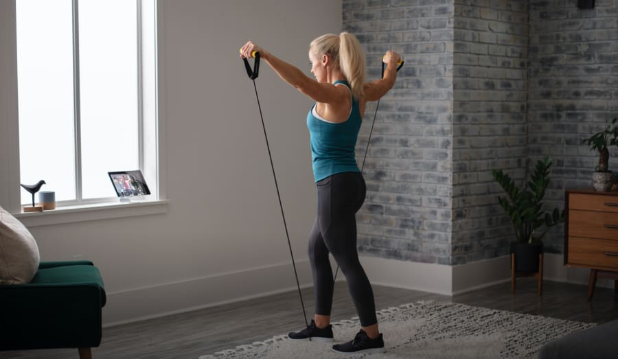 Woman working out using the Light Resistance Tube.