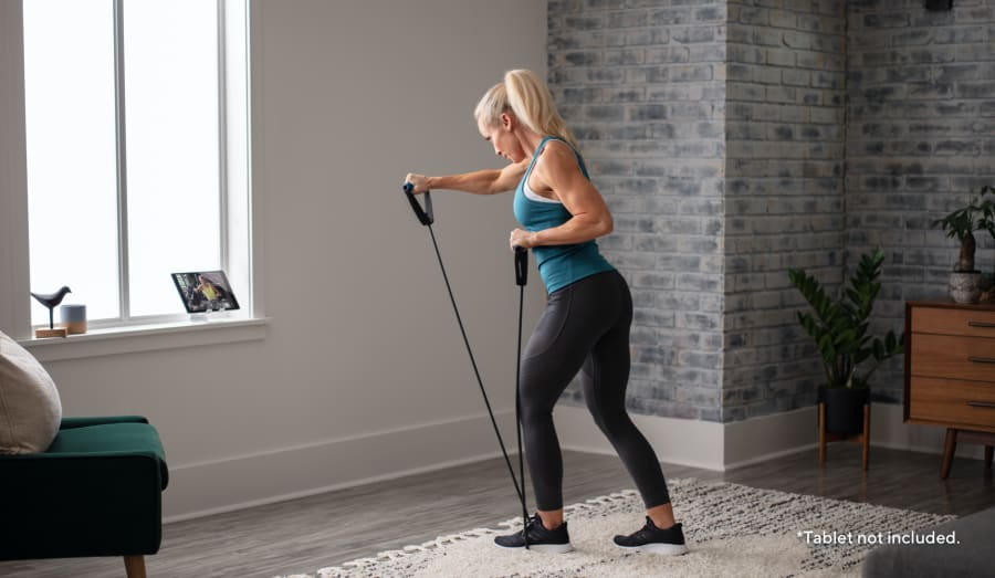 Woman working out using the Heavy Resistance Tube.