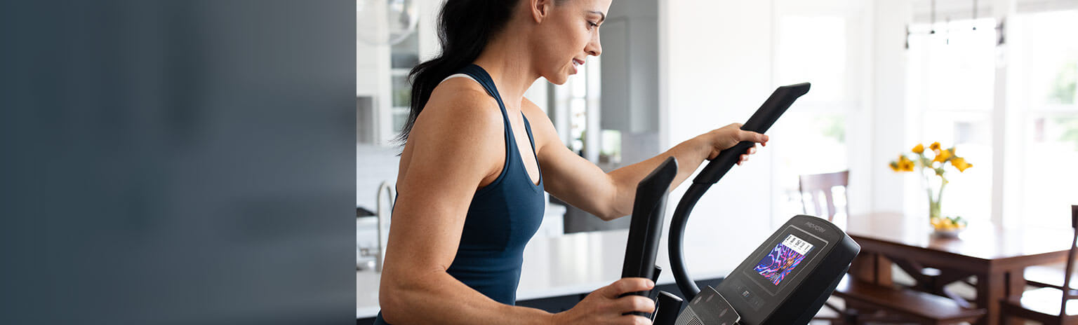 woman exercising on the Carbon E7 elliptical large