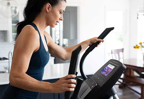 woman exercising on the Carbon E7 elliptical