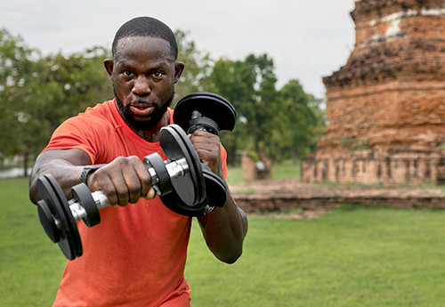 man using dumbbells to exercise small