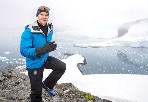 man running along side a glacier small