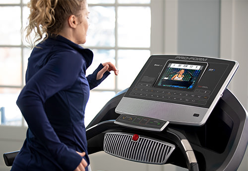 woman running on a treadmill in her home