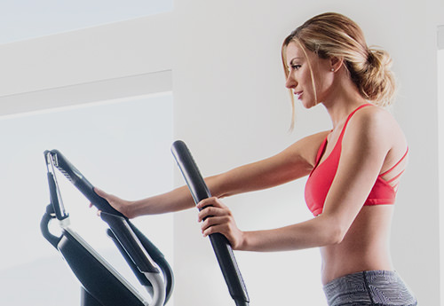 woman training on a performance 720 e elliptical