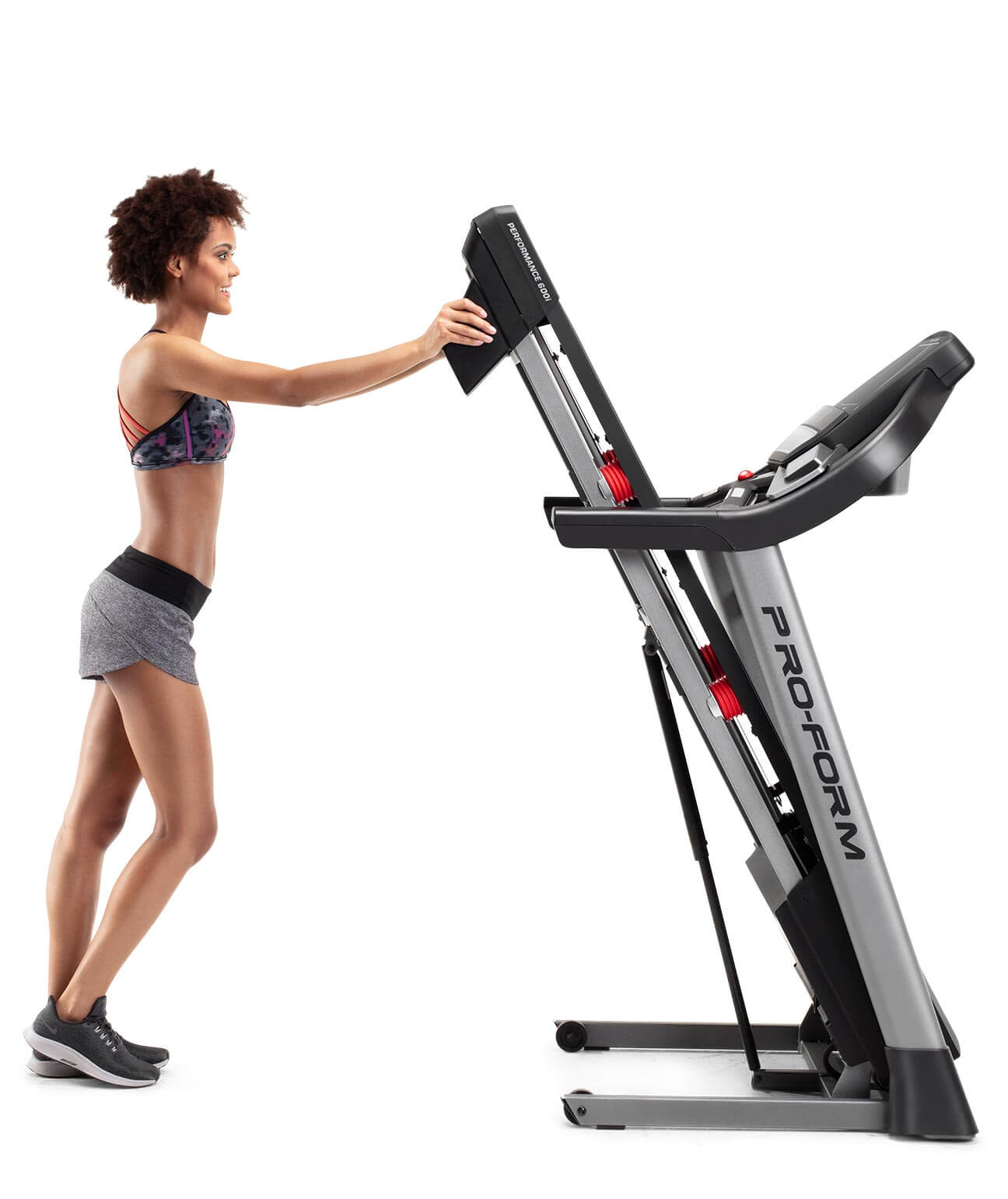 woman folding the performance 600i treadmill