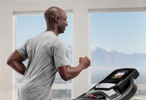 Man running on the SMART Performance 400i treadmill.