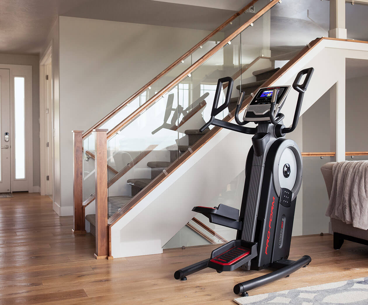 Carbon HIIT H7 stored perfectly right by a stairway.