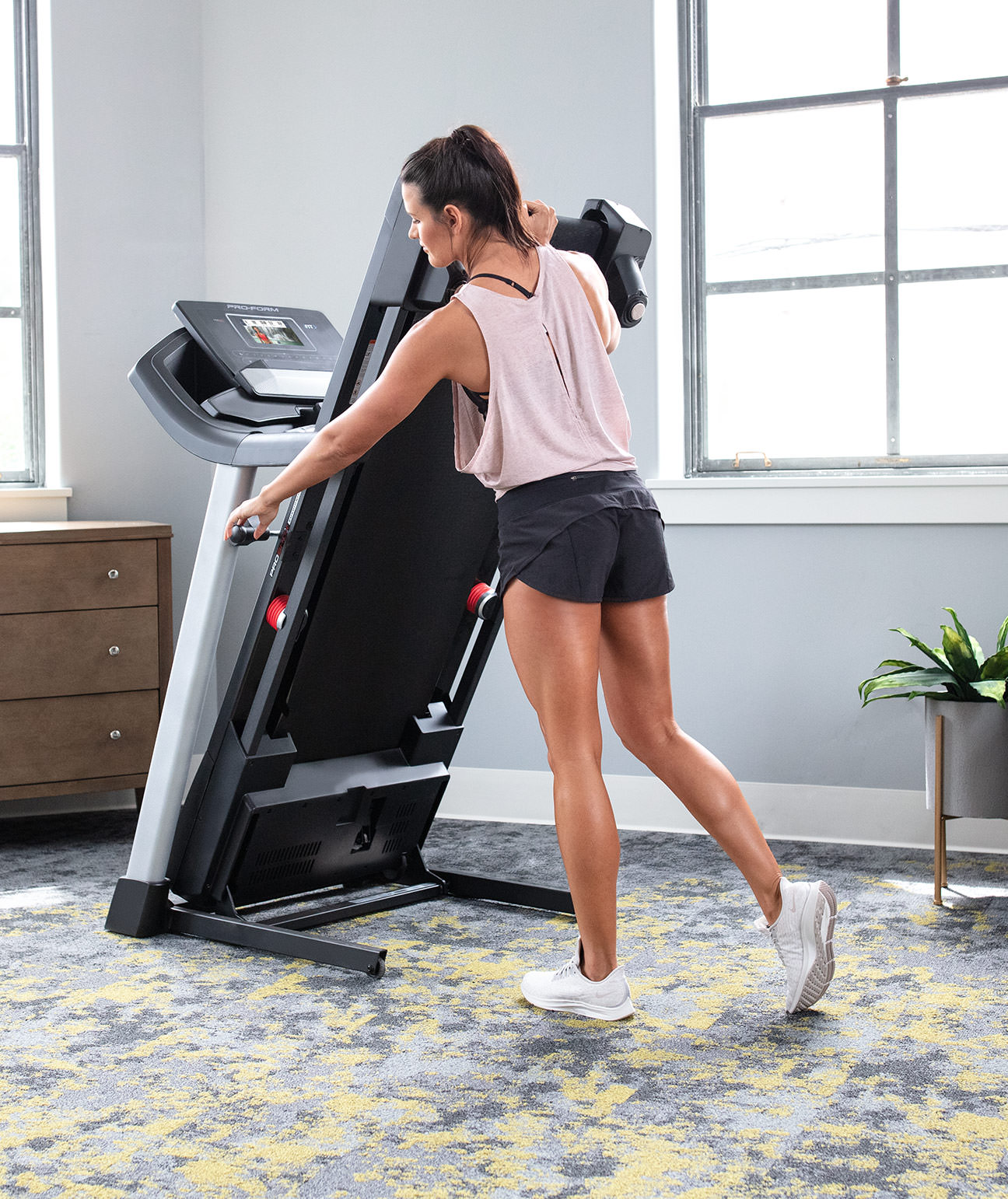woman folding the treadmill